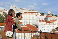 Portugal, Lisboa, Alfama, Largo das Portas do Sol, young couple enjoying vista - stock photo