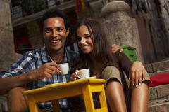 Portugal, Lisboa, Bairro Alto, young couple sitting at street cafe at dusk Stock Photos