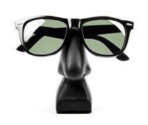black sunglasses on holder isolated on white - stock photo