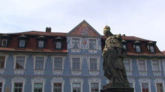 Statue and blue building in Bamberg Stock Footage