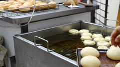 frying donuts - stock footage