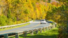 Panning From Trees to Vehicle on Autumn Colored BlueRidge Parkway Stock Footage