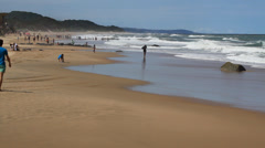 Two guys walking on Kwazulu-Natal North Coast Beach Stock Footage
