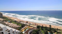 Wide pan of Umhlanga Rocks Coastline Durban South Africa Stock Footage
