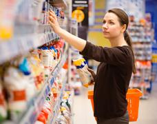 Young woman shopping for cereal, bulk in a grocery supermarket Stock Photos