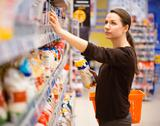 Stock Photo of young woman shopping for cereal, bulk in a grocery supermarket