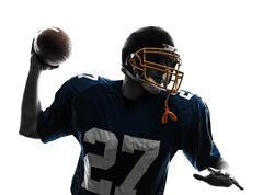 quarterback american throwing football player man silhouette - stock photo