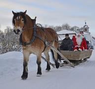 Santa Claus go to  sleigh ride with brown horse Stock Photos