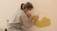 woman worker hand sanding a wall in a home - stock footage