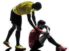 Two men soccer player  fair play concept  silhouette Stock Photos