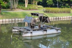 water wheel floating on the canal of park - stock photo