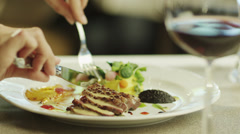 Woman Eating Delicious Meat Dish in Luxury Restaurant Stock Footage