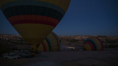 Hot-air balloons are inflated with hot air before the flight at dawn. Timelapse. Stock Footage
