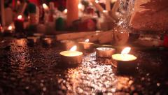 Mandela Death - Houghton Residence - CU tealight candles on road Stock Footage