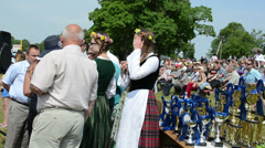 Horse race cups and girls prepare to give awards Stock Footage