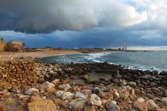 sea coast and ruins of caesarea maritima, israel - stock photo