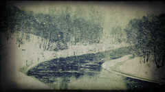 Snowfall and winter calm river scene. Retro styled Stock Footage