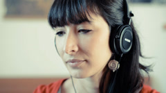 young beautiful hipster woman listening to music - stock footage