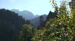 Back light castle in the mountains - Bavaria Stock Footage
