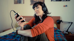 Young beautiful hipster woman listening to music Stock Footage