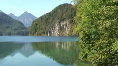 Still waters of Schwansee lake in the Alps Stock Footage