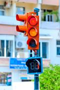 Traffic light on the background of a city street Stock Photos