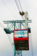 red cabin of a chair lift at mount tahtal?. - stock photo