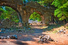 Aqueduct ruins in the ancient city of phaselis Stock Photos