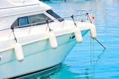 white fenders on aboard the yacht - stock photo