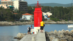 Red lighthouse in old town Krk, Croatia Stock Footage