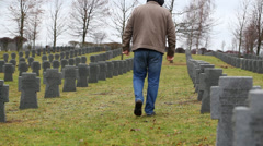 Man near soldier's grave - stock footage