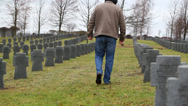 Stock Video Footage of Man near soldier's grave