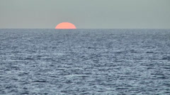 KeyWest 132HD, last Moment of Sunset, leaving Sun at Horizon of open Sea Stock Footage