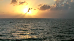 KeyWest 128HD Sunset and evening mood. sun and clouds at open sea Stock Footage