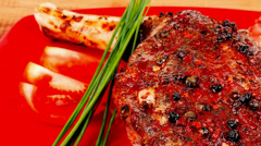 Roast meat shoulder on red with tomatoes Stock Footage