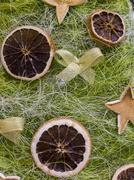Original christmas decorations cut from dried orange peel. Stock Photos