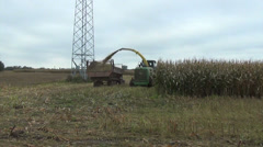 Seasonal agricultural corn field harvest with industrial machine Stock Footage