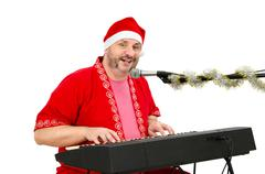 Stock Photo of man in santa claus suit singing a song