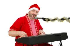 Stock Photo of santa plays and sings on electric piano