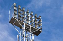 lighting floodlights at the stadium - stock photo