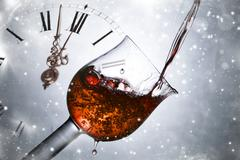 red wine against fireworks holiday lights close to midnight - stock illustration