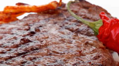 Meat steak on white round plate Stock Footage