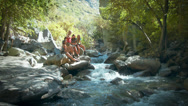 Stock Video Footage of Group of Five Teenage Girls On Boulders Next To A Mountain Stream