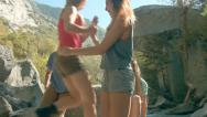 Stock Video Footage of Group of Five Teenage Girls Arriving, Sitting Next To A Mountain Stream