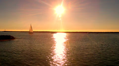 Fast Motion Boats Enter Newport Beach Harbor Under Setting Sun Stock Footage