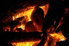 fire with rocks and logs - stock photo
