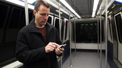 Man Uses Smartphone on Train 3897 - stock footage