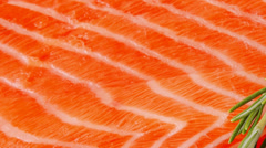 Salmon fillet on wood plate and rosemary Stock Footage