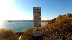 Prohibited Activities Warning Signs- Corona Del Mar Beach- Newport Beach CA Stock Footage