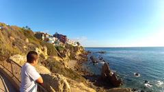 Young Hispanic Man Looks Out To Sea- Corona Del Mar Beach CA Stock Footage